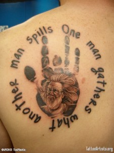 Jerry Garcia tatoo with quote and his famous hand print